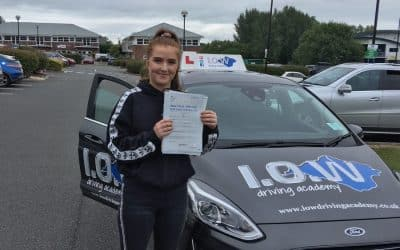 Ella passes with 5 driving faults.